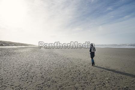 denmark henne strand person walking alone