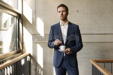 businessman with cup of coffee in