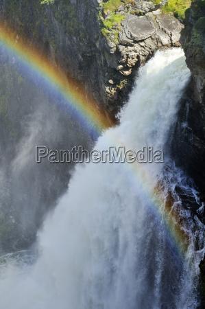 sweden gaeddede rainbow at waterfall haellingsafallet