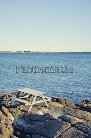 sweden varberg bench at rocky coastline