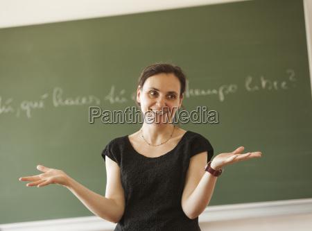 austria teacher in front of blackboard
