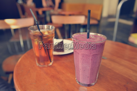 glasses with blueberry milkshake and iced