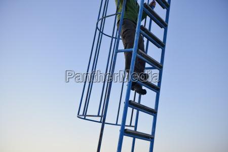 sweden storuman man climbing on ladder
