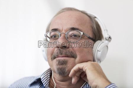 germany senior man wearing head phones