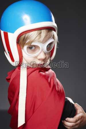 portrait of boy with racer helmet