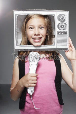 girl speaking in microphone in paper