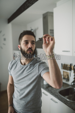 young man playing darts in his