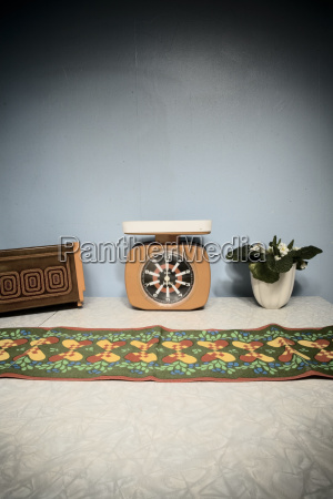 retro scale toaster and flower