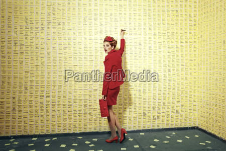 woman standing at wall covered with