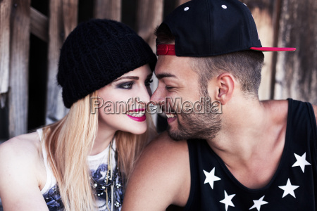 smiling young couple rubbing noses