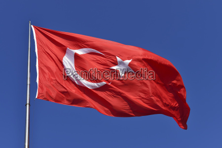 turkish flag in blue sky