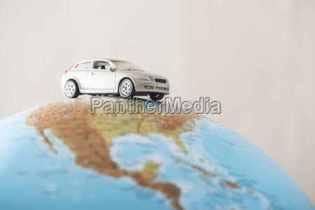 toy car on a globe