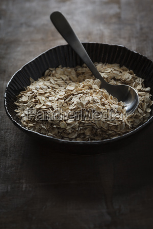 bowl of oat flakes with spoon