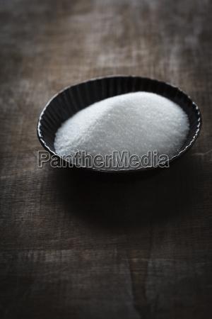 bowl of sugar on table close