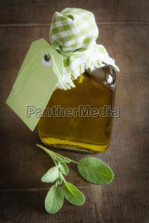 salvia olive oil in bottle close