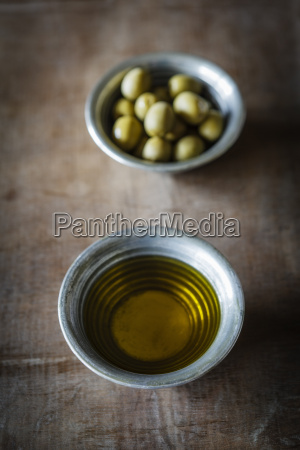 olives and olive oil on table