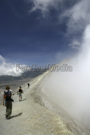 indonesia java travellers hiking on crater