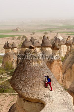 turkey cappadocia tourist climbing on fairy
