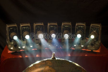 slide projectors projecting on globe