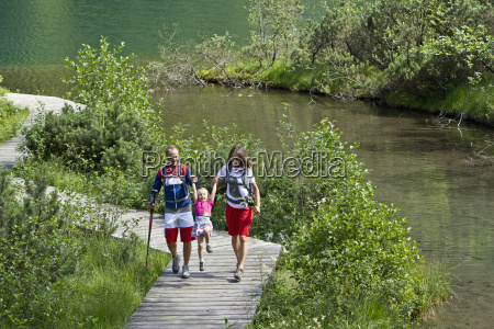 germany bavaria chiemgau family walking at