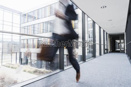 businessman running in corridor of an
