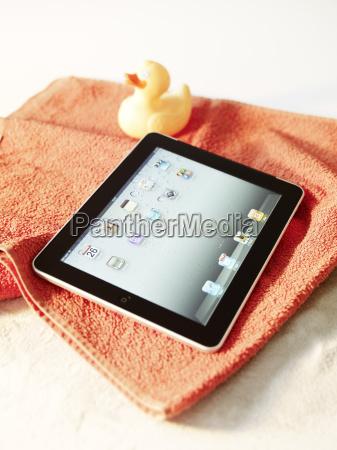 digital tablet on beach towel symbol