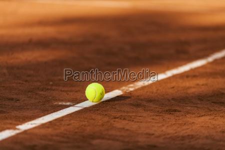 tennis ball hitting the line on