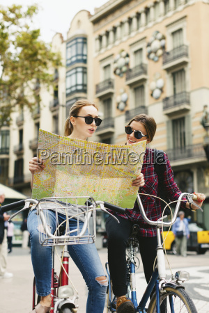 spain barcelona two young women with