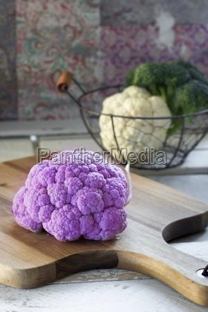 purple cauliflower on wooden board