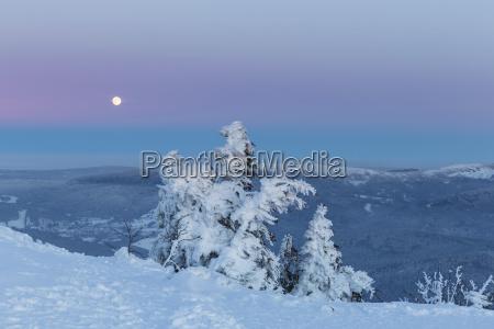germany bavaria moonrise on summit of