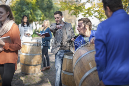 wine salesman guiding wine workers with