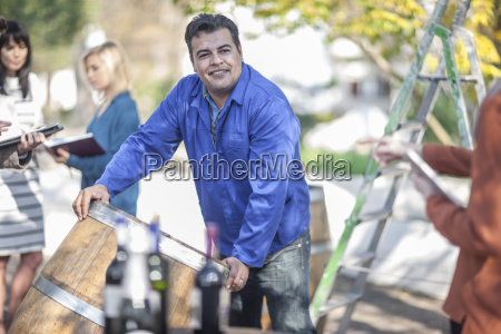wine barrel worker with saleswoman outdoors