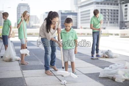 group of volunteering children collecting garbage