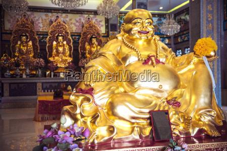 thailand kanchanaburi golden buddha statues in