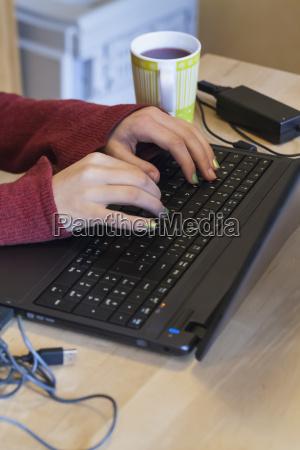 germany laupheim teenage girl using laptop