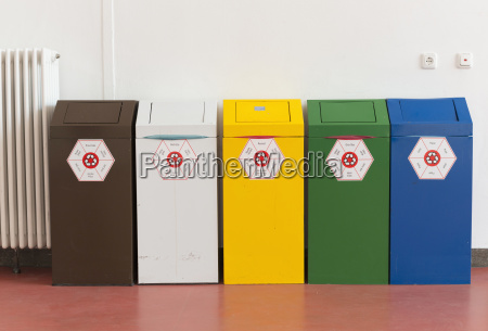 five recycling bins at technical university