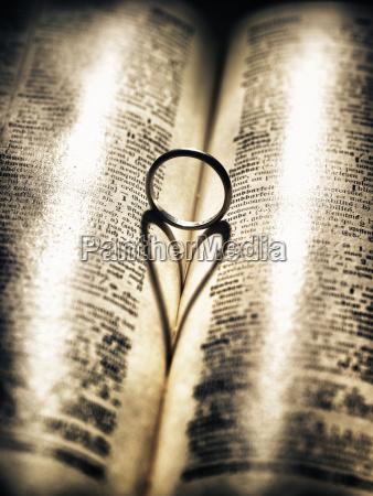 heart shaped shadow in open book
