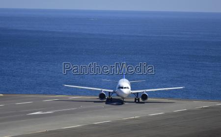 portugal madeira airplane on runway atlantic
