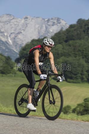 germany marktschellenberg sportive woman riding bicycle