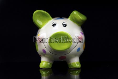piggy bank on black background close