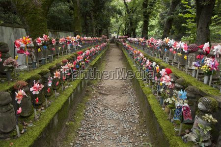 japan tokyo jizo statues decorated with