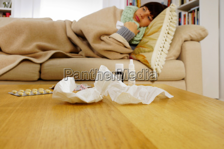 sick woman lying on sofa