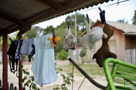 washed cuddly toys and laundry hanging