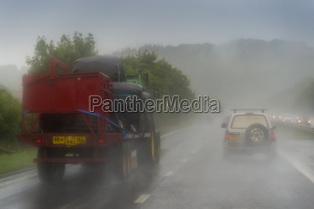 tractor with trailer on highway in