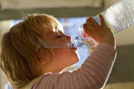 girl drinking water from bottle close