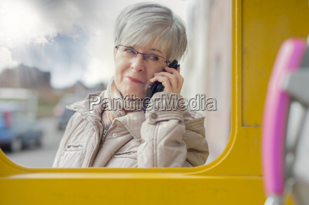 portrait of smiling senior woman telephoning