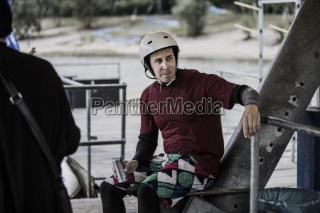 germany garbsen waiting wakeboarder with beverage