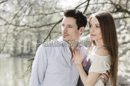 couple watching something in front of