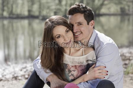 portrait of happy couple sitting near