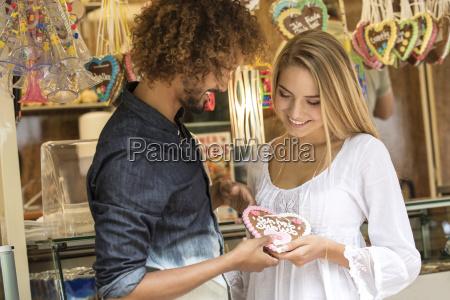 young man gifting his girl friens